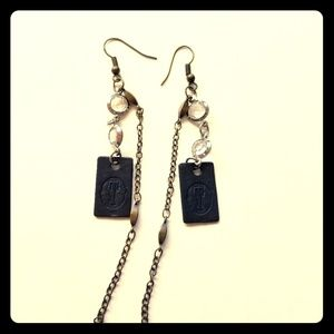 Earrings with a stamped letter T
